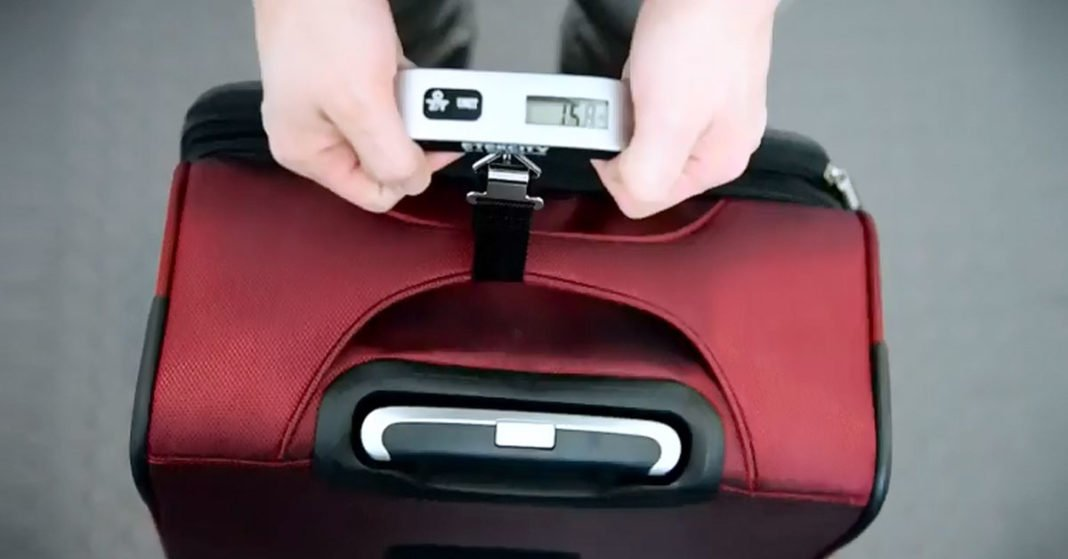 Avoid Overweight Fees With This Digital Hanging Luggage Scale