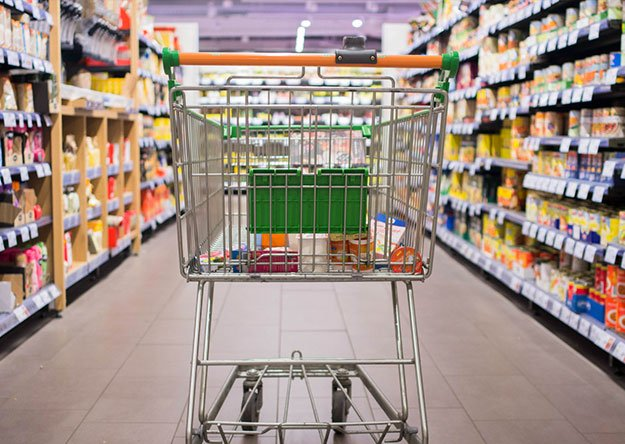 Shopping cart moving through isle of market