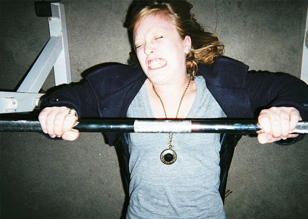 woman lifting gym bars