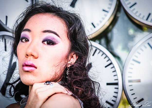 woman with time clocks behind