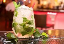 Glass of Mojito with lime and crashed ice in it