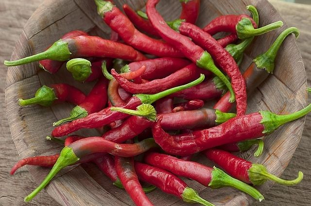 Handfull of red chilis in a bowl.