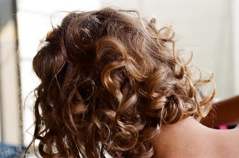 How do you apply flaxseed gel to define curls